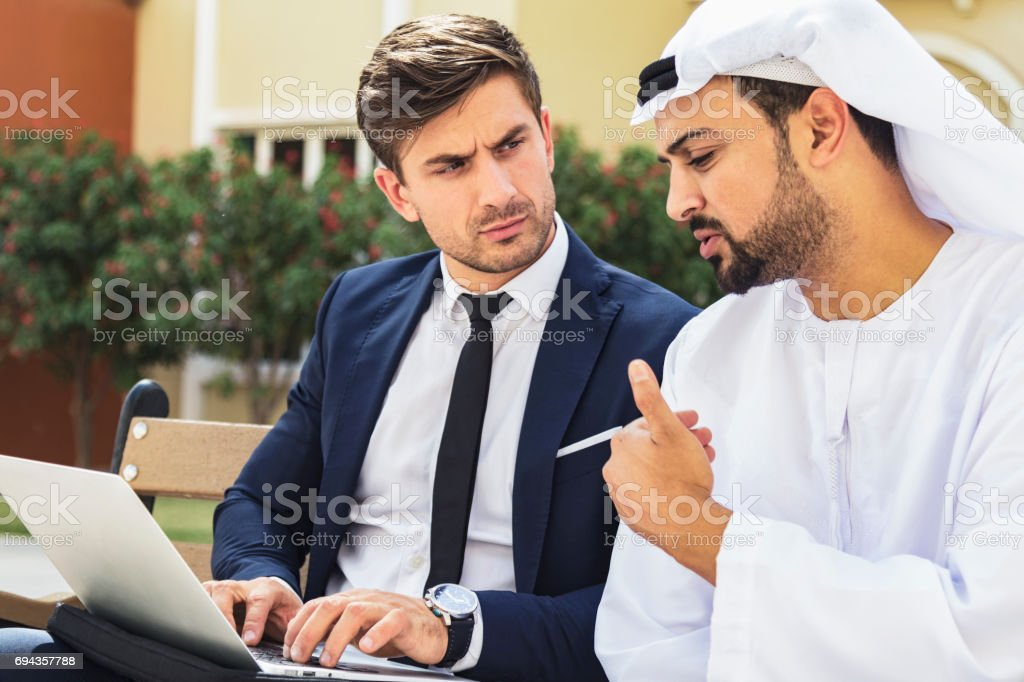 Business executive having a conversation with an Arabian businessman stock photo
