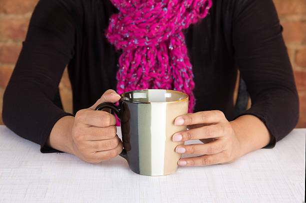 Business executive having a cup of coffee stock photo