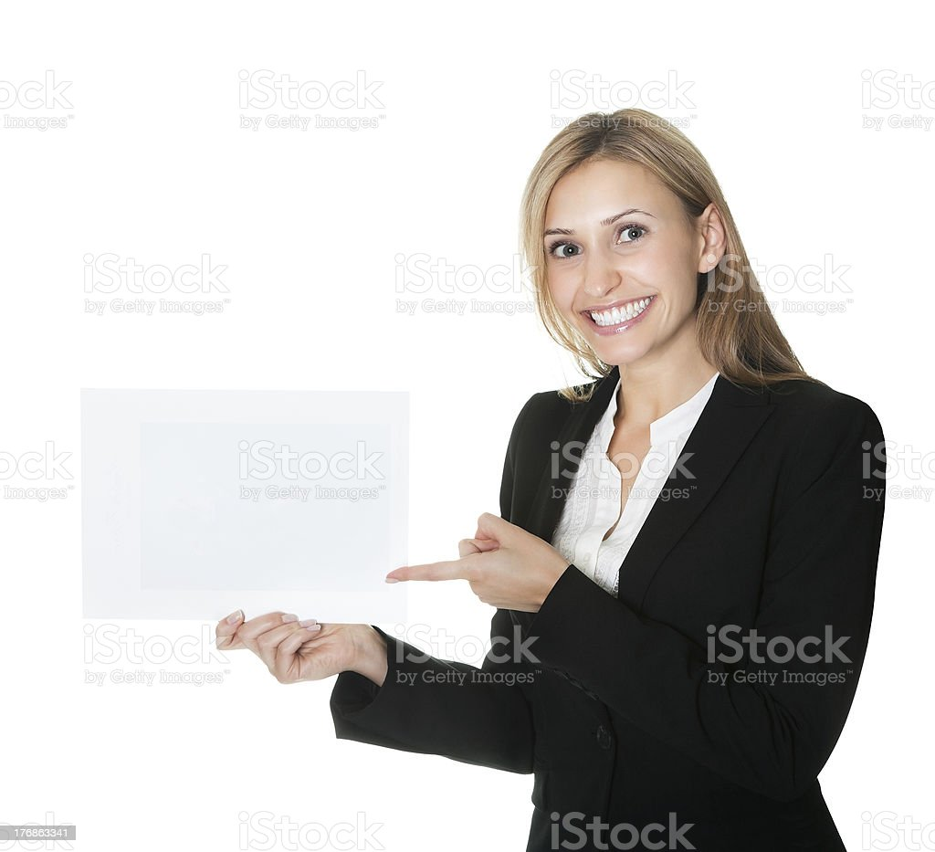 Business executive pointing at an empty billboard in her hand royalty-free stock photo