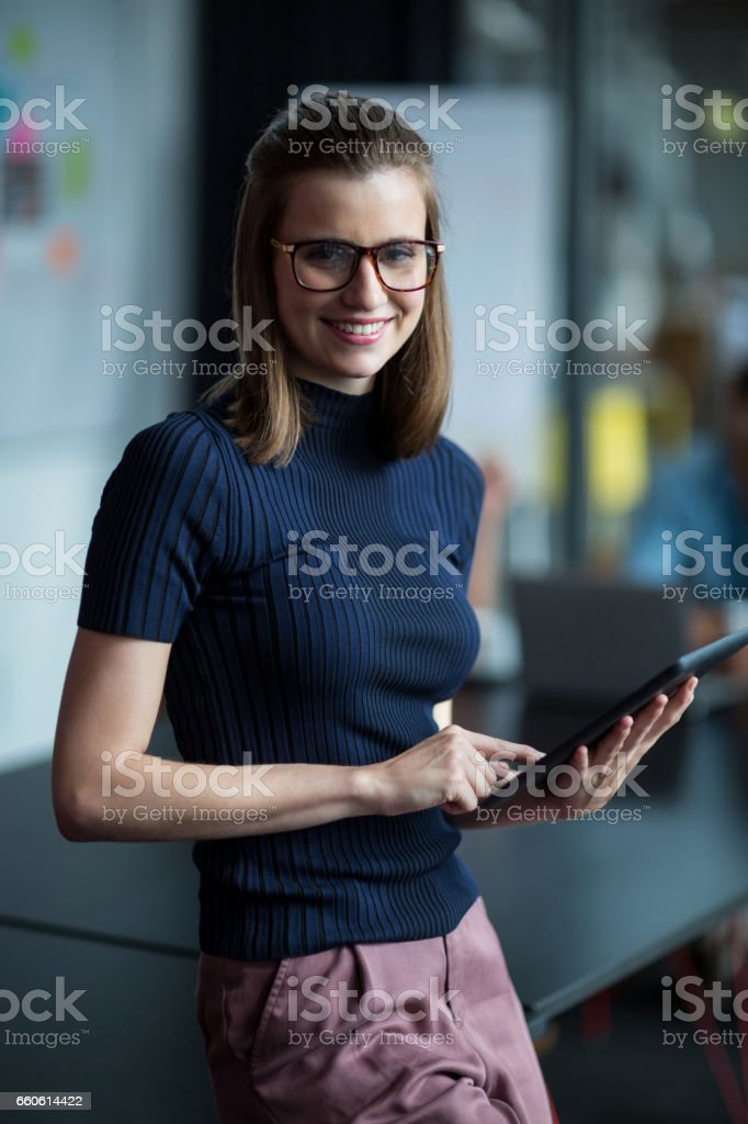 Business executive using digital tablet in office royalty-free stock photo