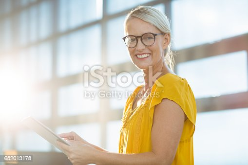 istock Business executive using digital tablet 652013178
