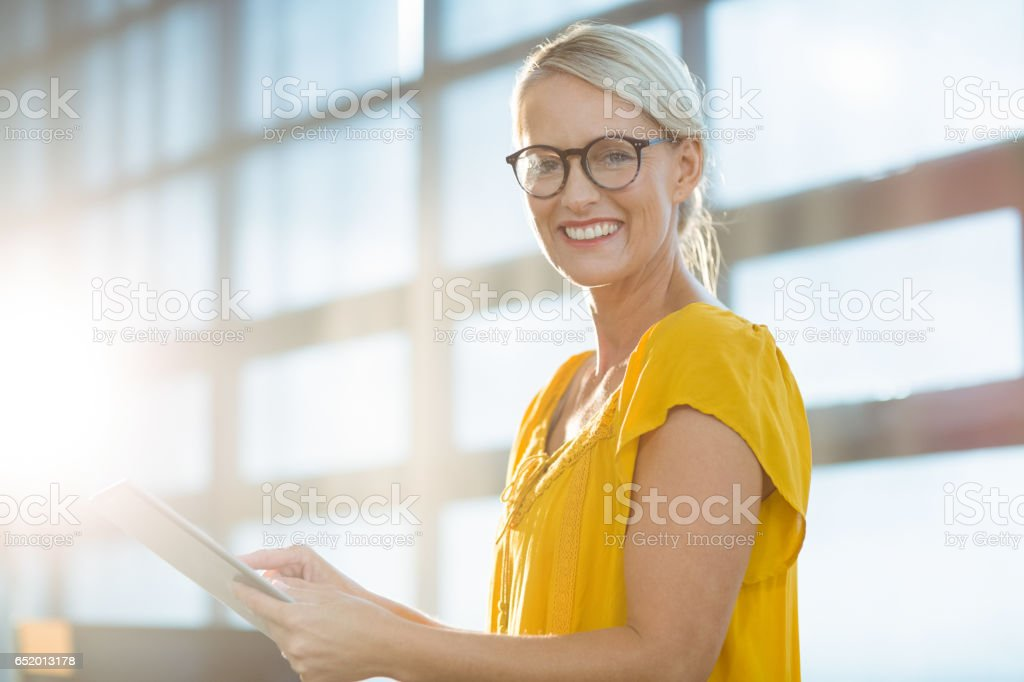 Business executive using digital tablet stock photo