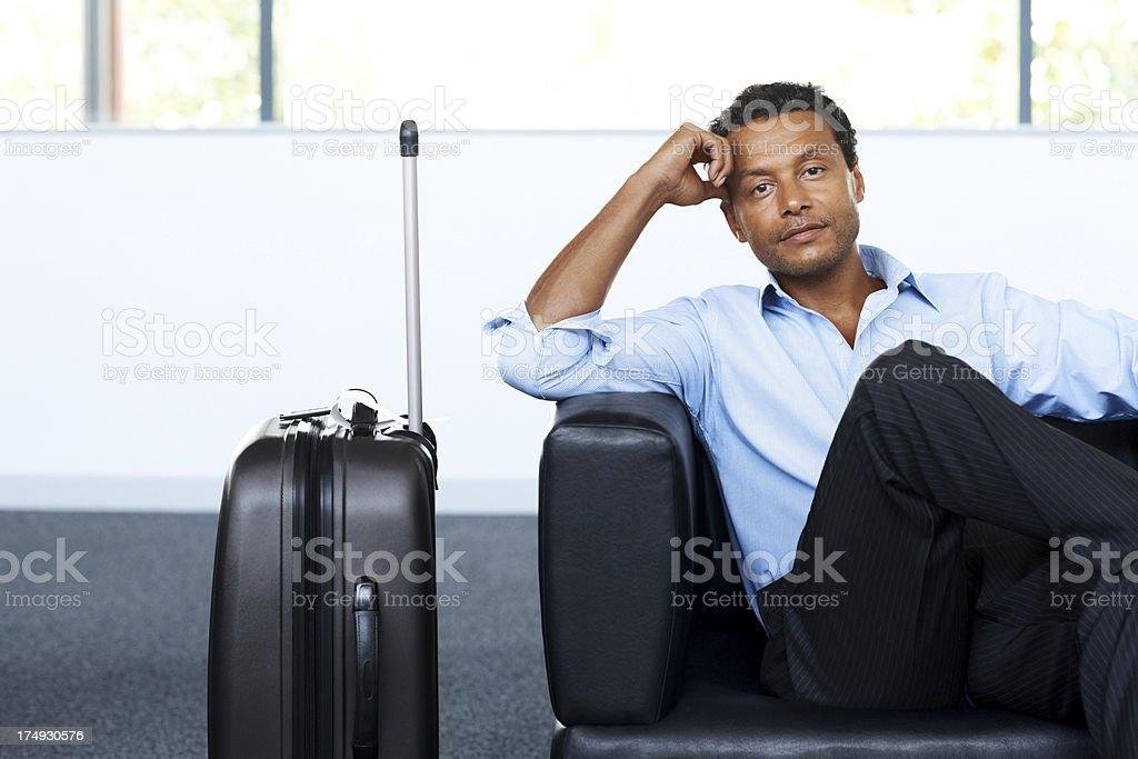 Business executive waiting for his flight at airport royalty-free stock photo