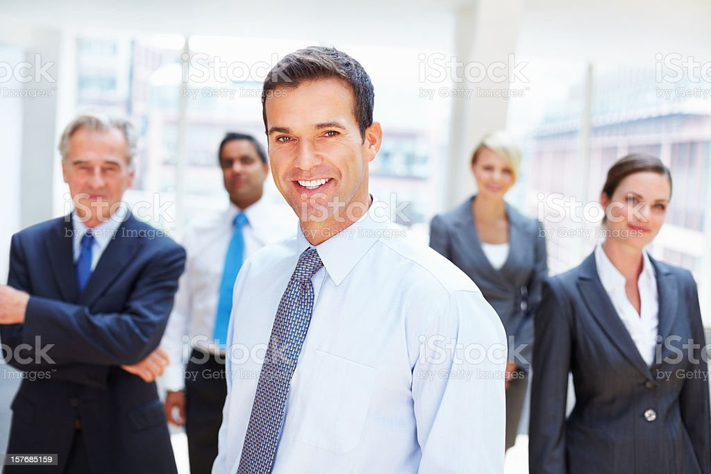 Business executive with team in the background royalty-free stock photo
