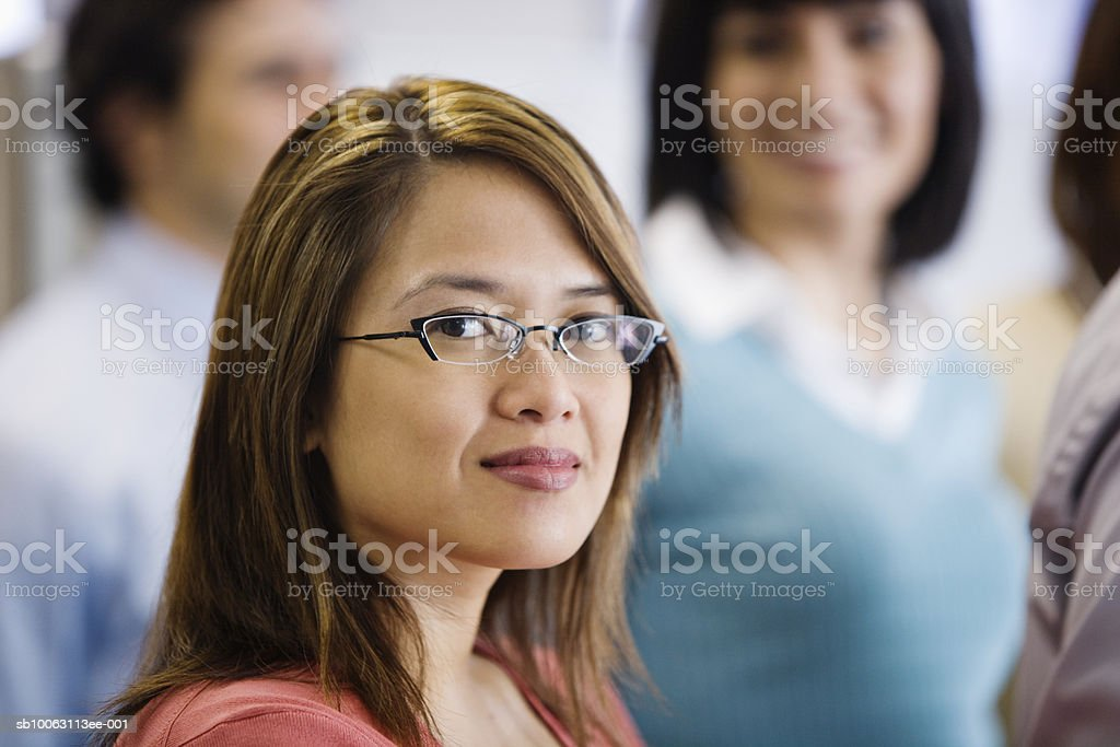 Business executive, woman smiling in foreground foto de stock libre de derechos