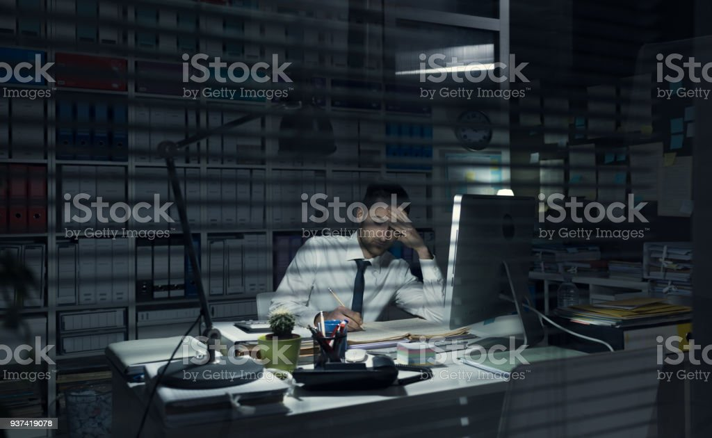 Business executive working late at night stock photo