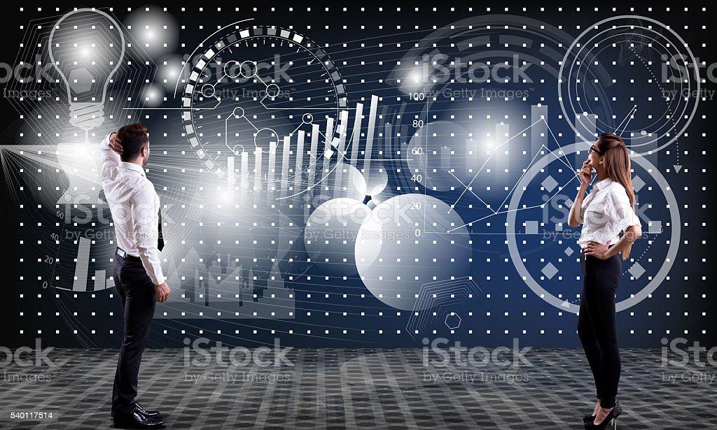 Business executives analyzing progress chart stock photo