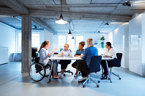 Business Executives Brainstorming In New Office Stock Photo - Download Image Now