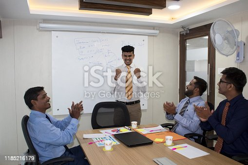 938516440 istock photo Business executives celebrating success 1185216179