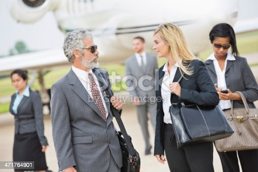 istock Business executives deboarding private jet 471764901