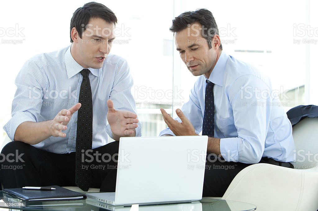 Business executives discussing business strategy stock photo