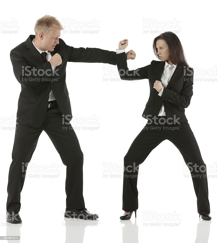 Business executives fighting stock photo