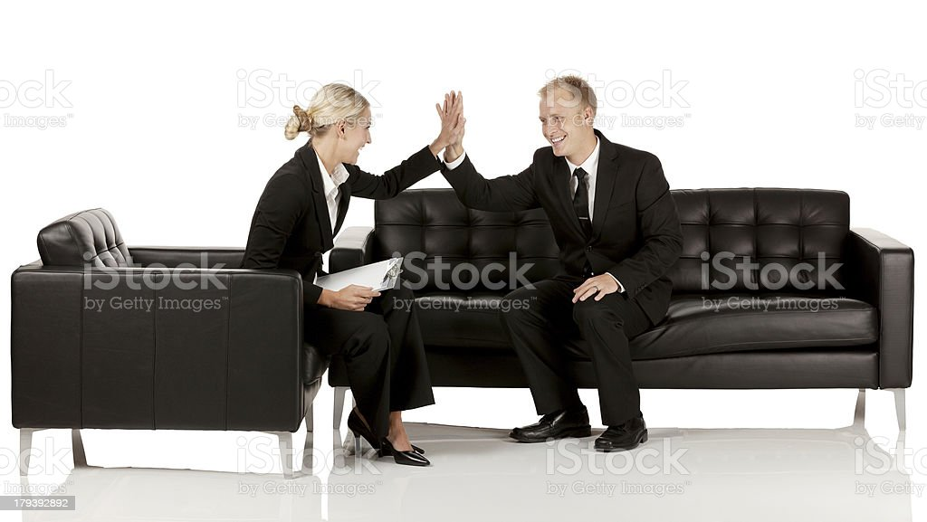 Business executives giving high five to each other royalty-free stock photo