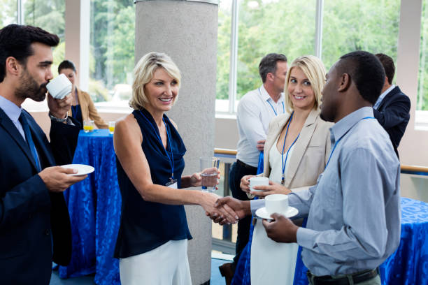 business executives interacting with each other while having coffee - event stock pictures, royalty-free photos & images