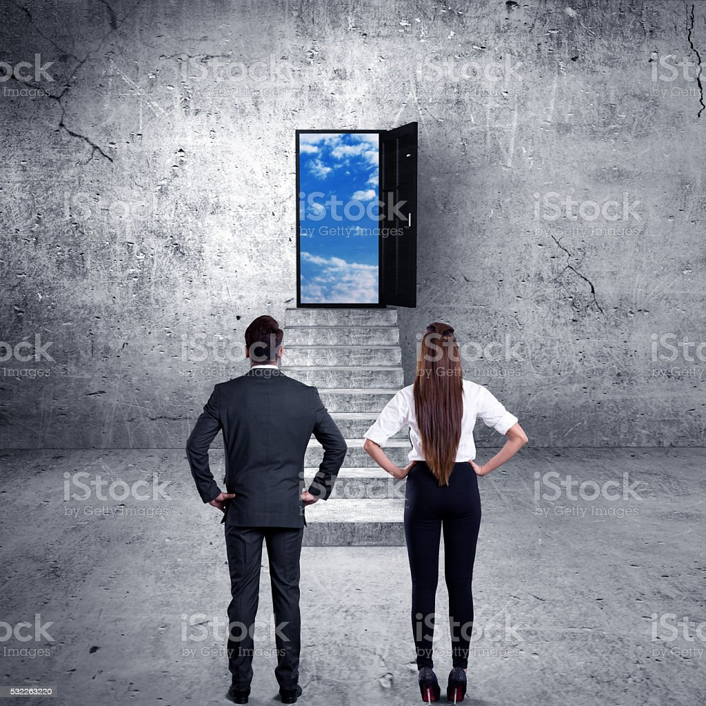 Business executives looking at open door stock photo