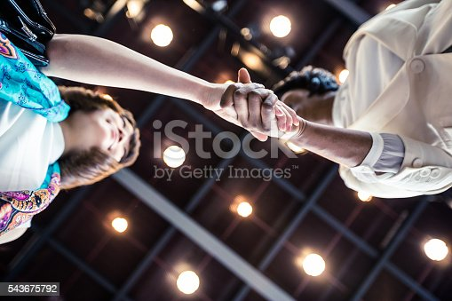 istock Business Executives shaking hands over an agreement. 543675792
