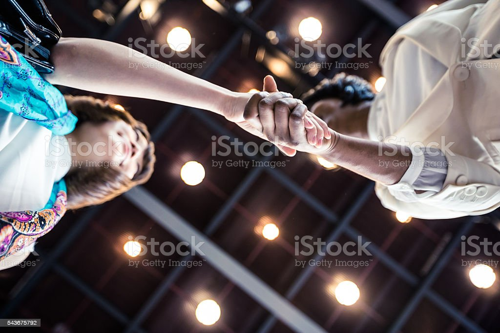 Business Executives shaking hands over an agreement. stock photo