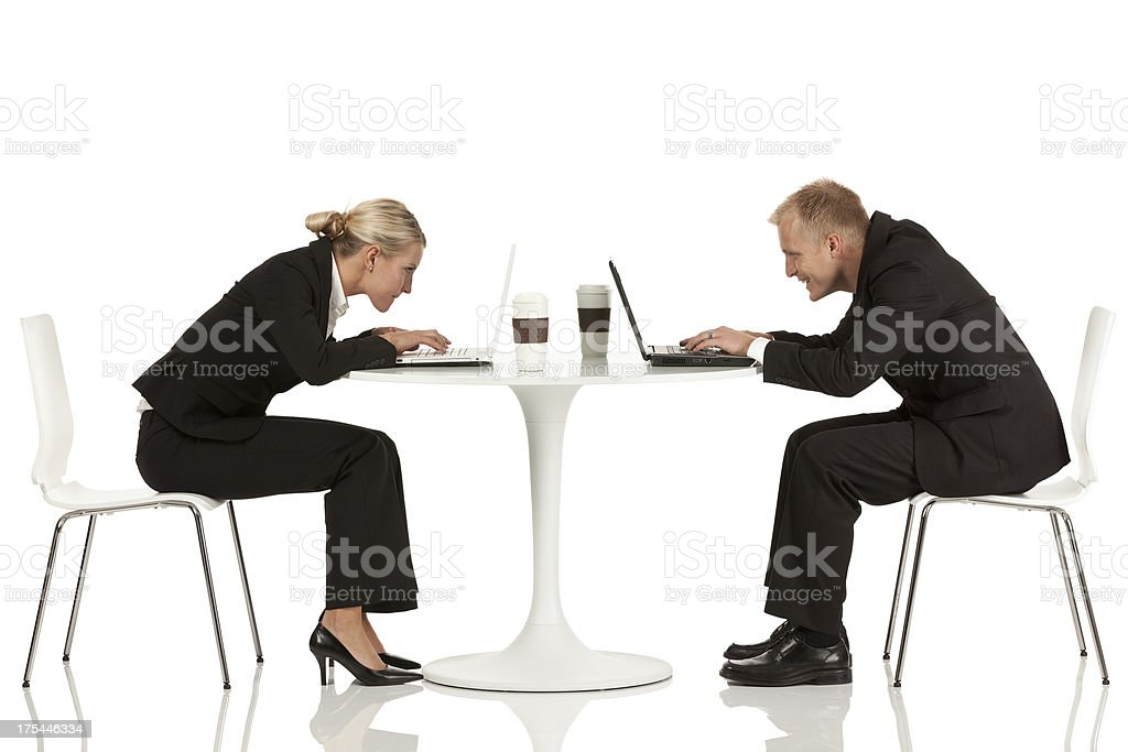 Business executives sitting across each other at a royalty-free stock photo