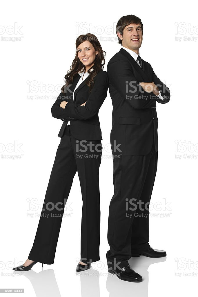 Business executives standing with arms crossed stock photo