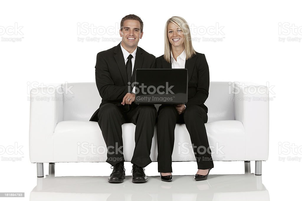 Business executives working on a laptop royalty-free stock photo