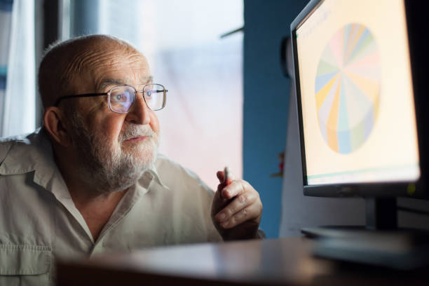 business expert analyzing a chart on computer screen - mouse pointer stock photos and pictures