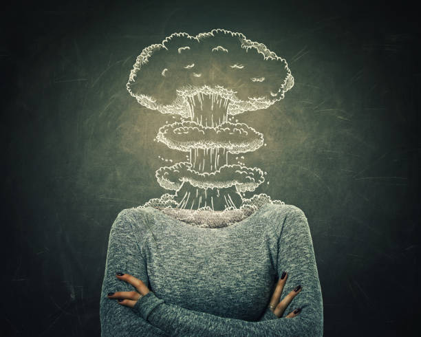 business failure Surreal image young woman head explosion over blackboard background. Mental state of human with lot of problems. Nervous person with crossed hands and a nuclear mushroom sketch, business failure. mental burnout stock pictures, royalty-free photos & images