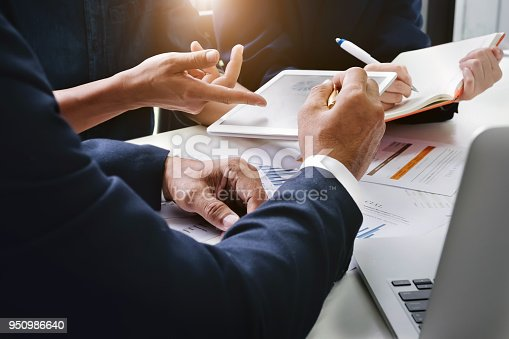 950986656istockphoto Business Finance, accounting, contract, advisor investment consulting marketing plan for the company with using tablet and computer technology in analysis. 950986640