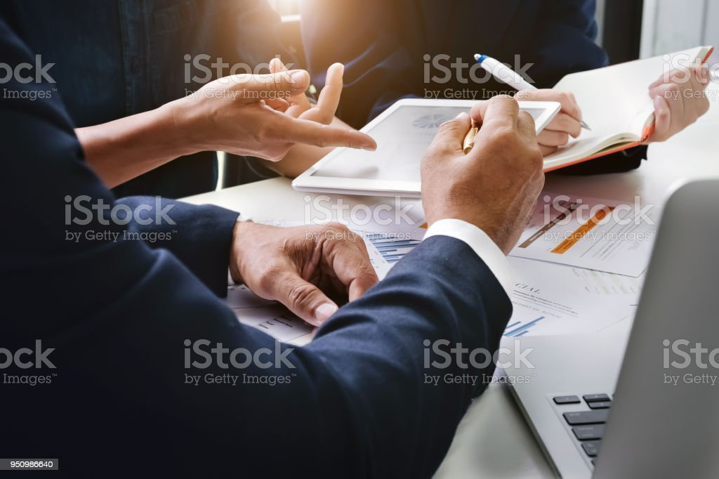 Business Finance, accounting, contract, advisor investment consulting marketing plan for the company with using tablet and computer technology in analysis. stock photo