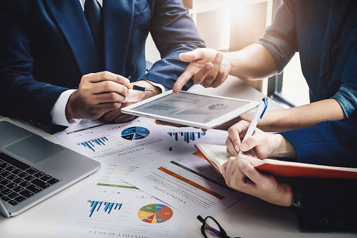 istock Business Finance, accounting, contract, advisor investment consulting marketing plan for the company with using tablet and computer technology in analysis. 950986656