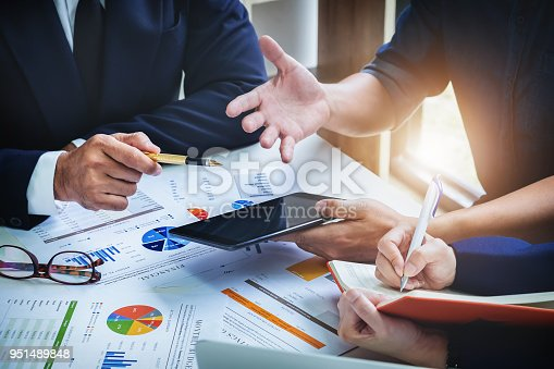 950986656istockphoto Business Finance, accounting, contract, advisor investment consulting marketing plan for the company with using tablet and computer technology in analysis. 951489848