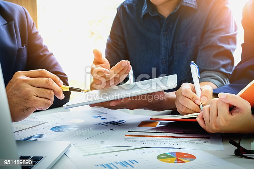 950986656istockphoto Business Finance, accounting, contract, advisor investment consulting marketing plan for the company with using tablet and computer technology in analysis. 951489890