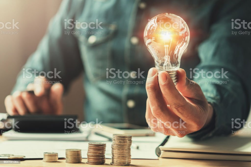 business finance and saving power. new idea solar energy with accounting concept stock photo