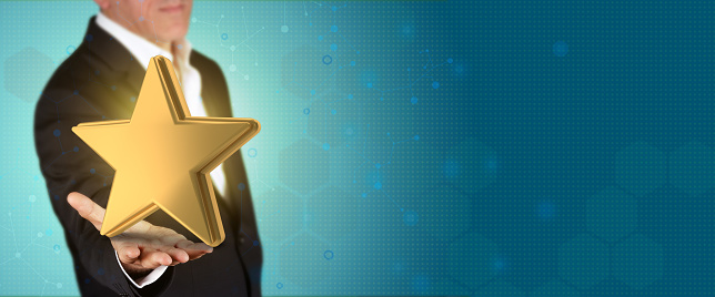 istock Business, Finance and winning Concept. Businessman presents gold star object in his hand. 1162252605