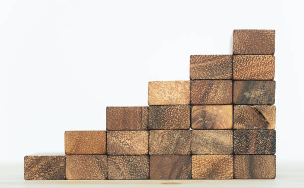 Business finance concept, wooden box stack, Businessman Building The Success.