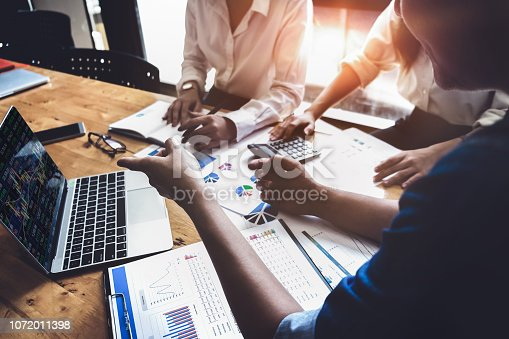 950986656istockphoto Business financial, accountant discussing with partner are meeting to audit finance planning sales to meet targets set in next year. stock market concept. 1072011398