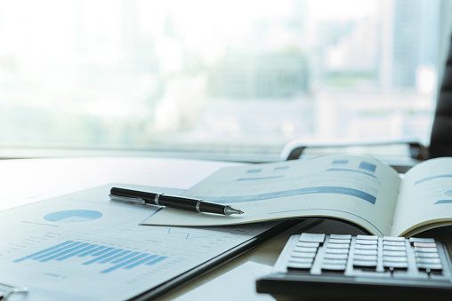 Data Analysis. Pen with business report on financial advisor desk. Concept of business planning , accounting, business analysis,financial planning services.