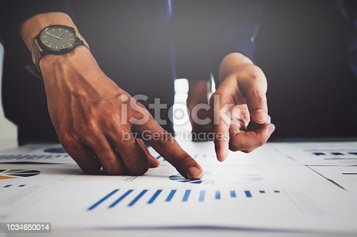 1032388356 istock photo Business financial, Business accountant using computer laptop and discussing with partner are meeting to audit finance planning sales to meet targets set in next year. budget plan concept. 1034650014