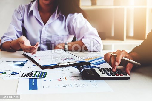 942382022istockphoto Business financial concept. busines man and partner pointing graph paper are meeting to plan sales to meet targets set in next year. 954482486