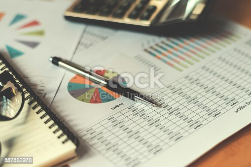 istock business financial concept with calculator pen and accounting report in office 887862970