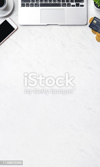 1060760900istockphoto Business financial design concept, marble white office table desk top view with smart phone, mockup credit card, coins, laptop, flat lay, copy space 1148825395