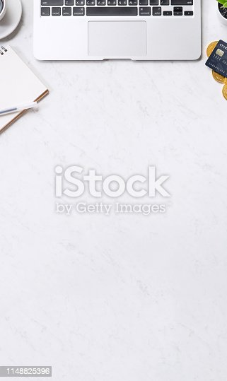 1060760900istockphoto Business financial design concept, marble white office table desk top view with smart phone, mockup credit card, coins, laptop, flat lay, copy space 1148825396
