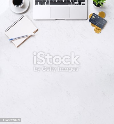 1060760900istockphoto Business financial design concept, marble white office table desk top view with smart phone, mockup credit card, coins, laptop, flat lay, copy space 1148825409