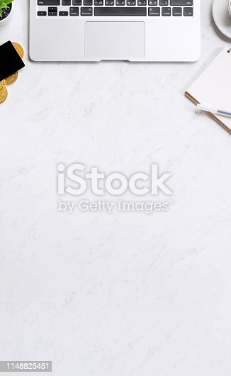 istock Business financial design concept, marble white office table desk top view with smart phone, mockup credit card, coins, laptop, flat lay, copy space 1148825451