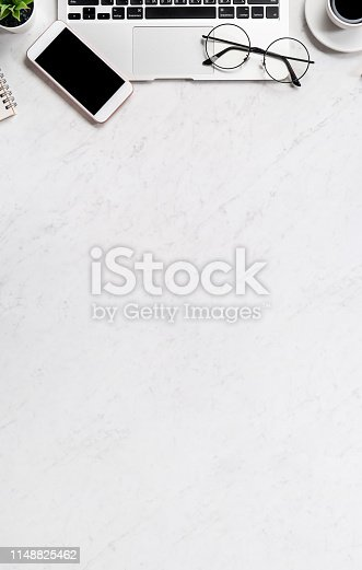1060760900istockphoto Business financial design concept, marble white office table desk top view with smart phone, mockup credit card, coins, laptop, flat lay, copy space 1148825462