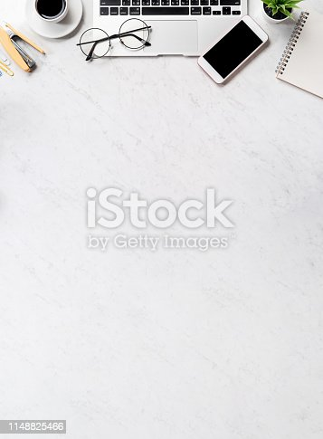 1060760900istockphoto Business financial design concept, marble white office table desk top view with smart phone, mockup credit card, coins, laptop, flat lay, copy space 1148825466