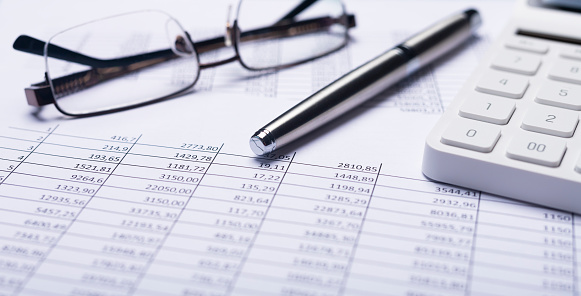 Business financial documents with calculator. Accounting concept.