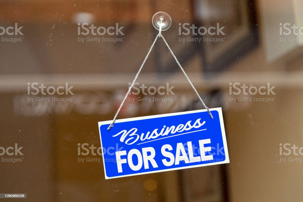 """Business for sale - For sale sign Blue sign hanging at the glass door of a shop saying: """"Business for sale"""". Blue Stock Photo"""