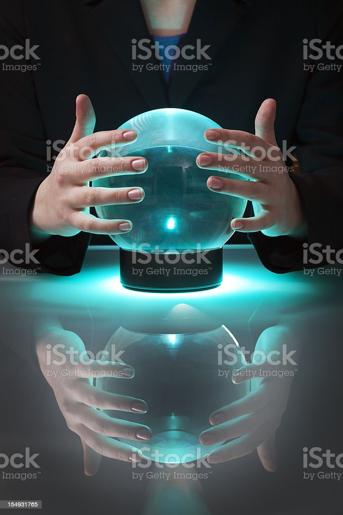 Business Fortune Teller with Crystal Ball Telling Forecasting Future stock photo