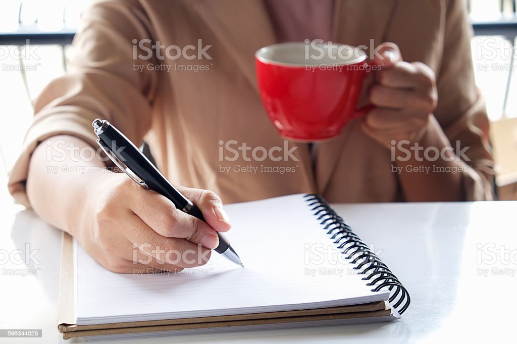 Business girl Hand write note and holding cup. royalty-free stock photo