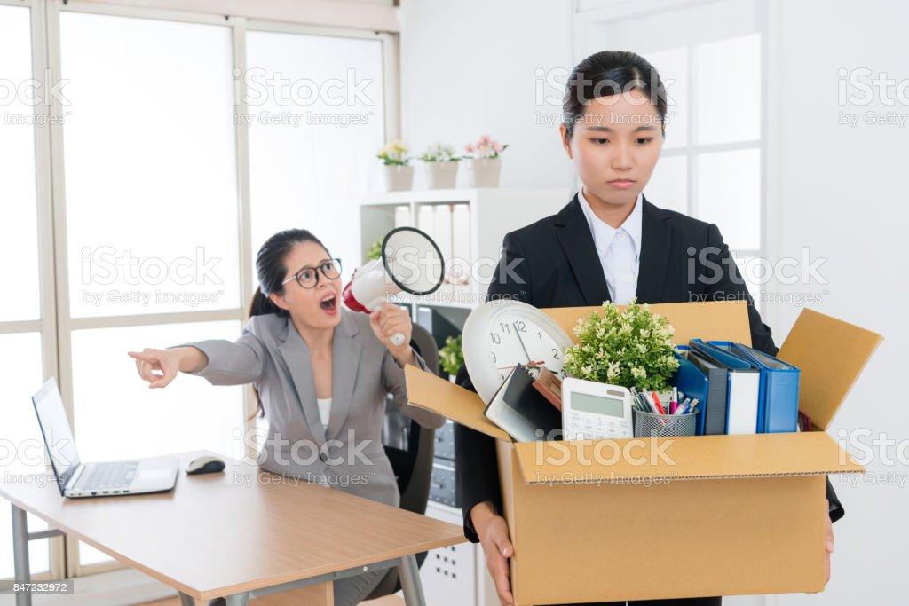 business girl holding personal belongings box stock photo